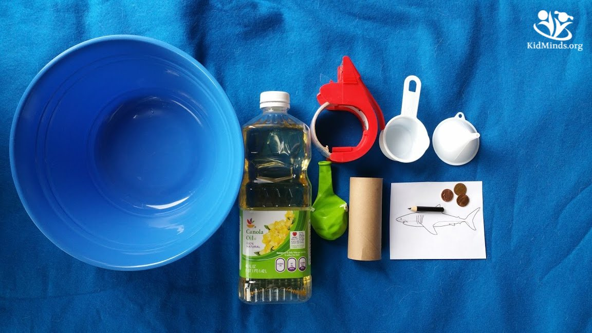 Shark #science for kids. This simple #shark experiment helps #kids understand how oil in shark's liver helps them float.  #handsonlearning #elementaryscience #scienceisfun #sharks #creativelearning