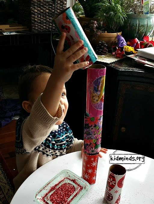 Turn your toilet paper rolls into bowling pins with a bit of wrapping paper and glitter.  Toddlers can practice rolling the ball toward the target.  Older kids can tape the numbers to the pins and practice some math.