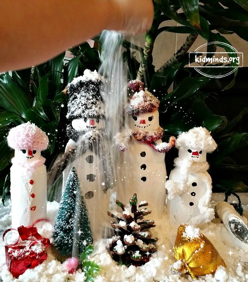 Papier-mache snowman family.  Artistic expression and sensory fun combine in this easy project.  Just find an empty bottle cover it with paper, then paint it and decorate as you desire!