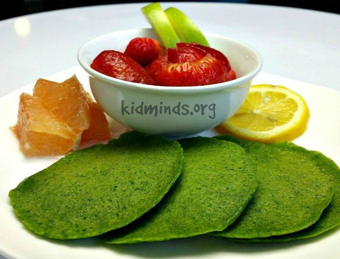 Green pancakes without artificial colorings.  The rich green color comes from fresh spinach. Perfect for St. Patrick's Day or any other day of the year!  #kidscook #handsonlearning #cookingwithkids #healthykids #kidsactivities #greenpancakes