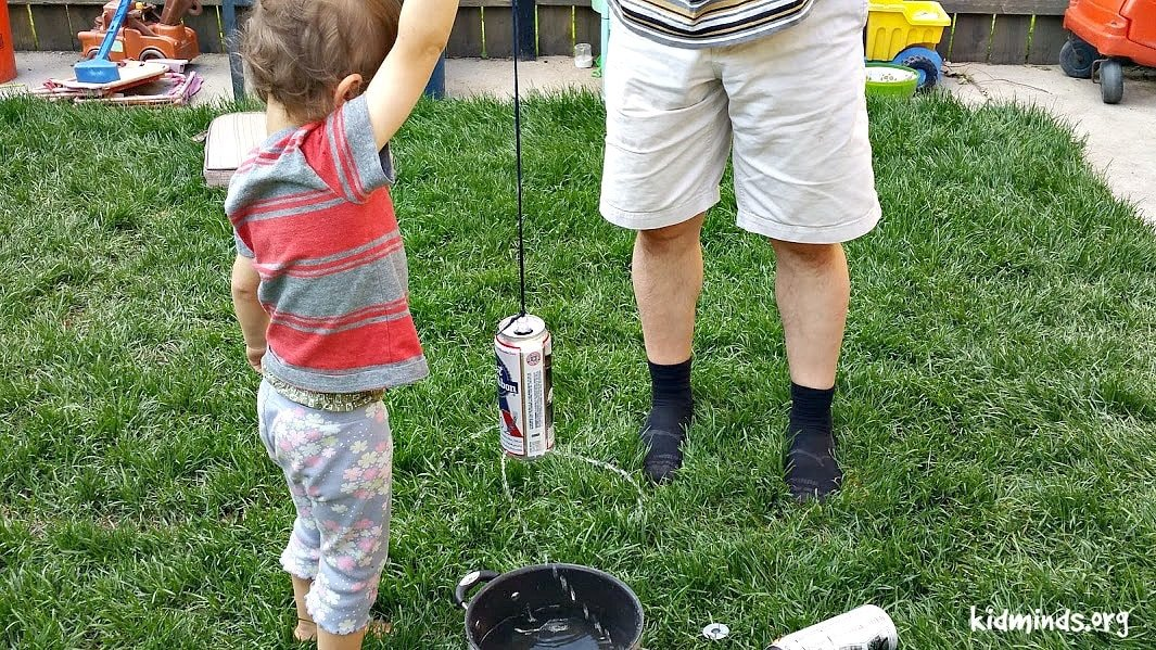 Twisting Soda Can experiment is a fun way to twist an empty soda can without touching with hands, but with the crafty use of the force of gravity. You can call it an Introduction toPhysics for Little Kids.  #physics #creativelearning #outdoorlearning #backyardscience #laughingkidslearn