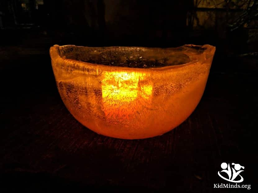 Can you combine ice and fire in one experiment? You bet! It will look like the ice is on fire, but the ice won't melt. Just the thing you need to celebrate winter solstice on December 21st. #wintersolstice #kidactivities #makingmemories #festivaloflight #winter #childrensactivities