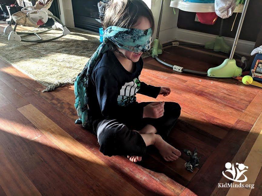 Dragon Keeper is a fun, no-prep game for the whole family. This game is perfect for the siblings to play at home, but it also works for parties.  #familyfun #siblingbonding #blindfoldgames
