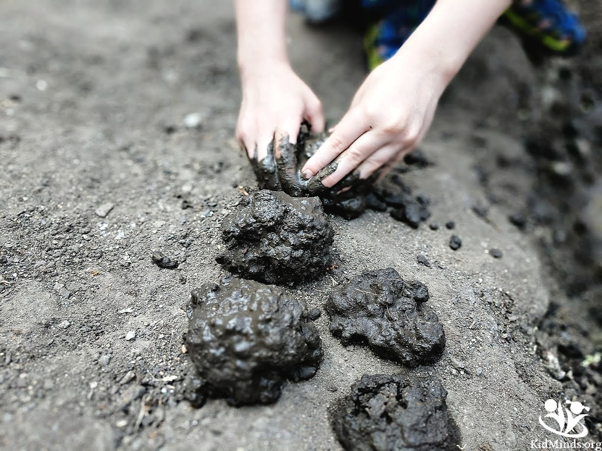 Childhood has changed, and activities like playing with mud don't seem to make anyone's summer bucket list these days. Get kids back outside for old-fashioned fun with nature and invite them to make sturdy mud sculptures. #mud #sensoryplay #summer #handsonlearning #kidminds #laughingkidslearn #outdoorfun #homeschooling