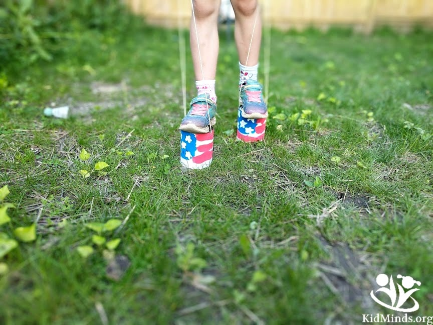 Stilt-walking is a great way to burn energy and have fun outside this summer. All you need are two cans of tomatoes and a rope. You can go all out and decorate the cans as we did. #summer #outdoorfun #stiltwalking #kidactivities #energyburners #kids #activekids #formoms #boredombusters #4thofjulycraft