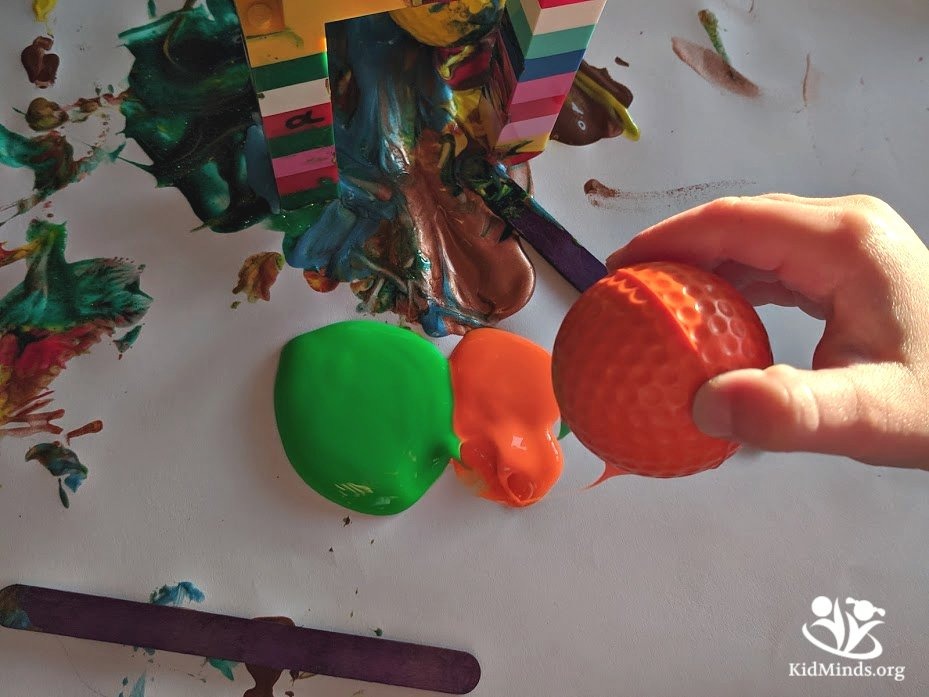 Use this simple idea to extend LEGO play to include science and art. Directing golf balls through the LEGO arch filled with paints combines the science of aerodynamics (interaction of air and bodies moving through it), engineering (constructing the arch), hand-eye coordination, and art. #handsonlearning #funlearning #STEAM #earlylearning #scienceforlittlekids #learningwell #laughingkidslearn #kidsactivities #kidminds #creativelearning #LEGOactivities #messyart