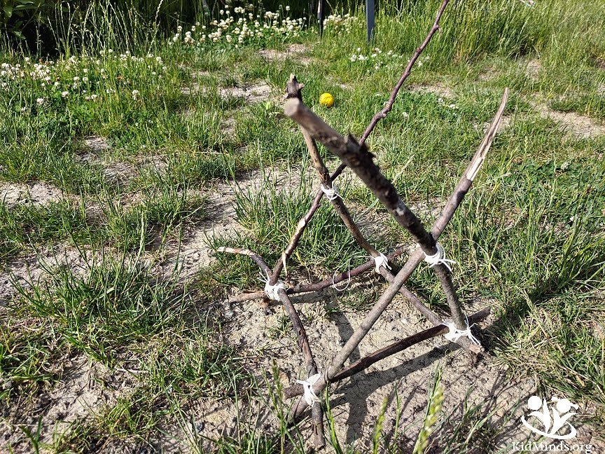 Can you build an Ewok catapult from sticks and stones with your little Star Wars fan? You bet! #kidsactivities #backyardscience #STEAM #handsonlearning #summer #kidminds #laughingkidslearn