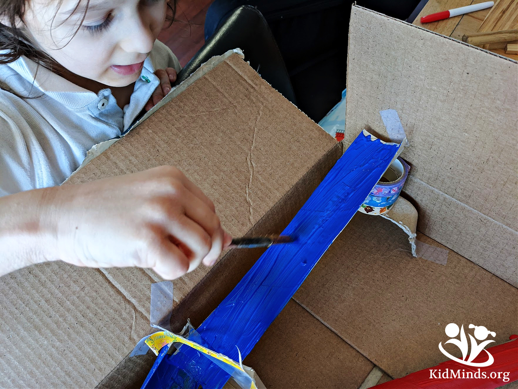 In this fun and simple STEM activity, there is plenty of opportunity to talk about inertia. #kidsactivities #STEM #cardboardbox #kidminds #handsonlearning #laughingkidslearn #marbles #learningallthetime